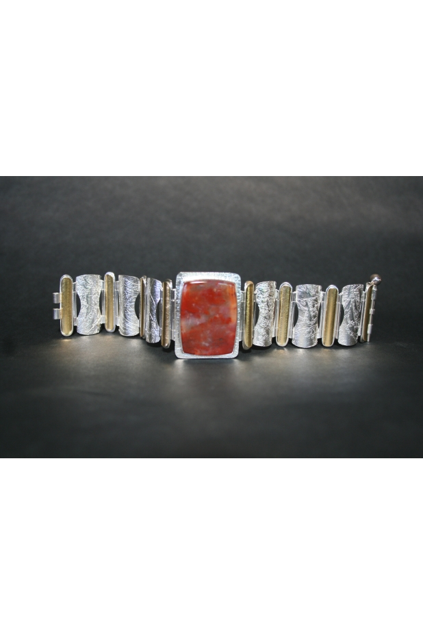 Hinged bracelet of sterling silver, 22k gold and plume agate.